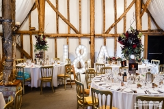 rustic wedding venue with light up signs
