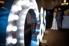 wedding couple with light up sign