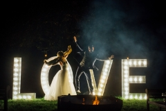 love sign with couple in front
