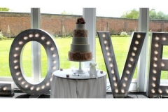 light up love sign at Luton Hoo wedding