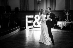Bride and Groom first dance in front of letters