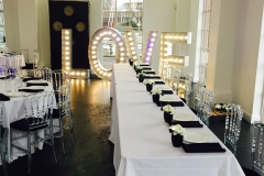 wedding table laid out with love sign at bottom