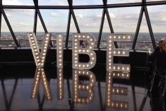 VIBE sign in light bulb letters