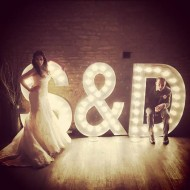 light up initials with wedding couple