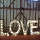 barn wedding with light up love sign