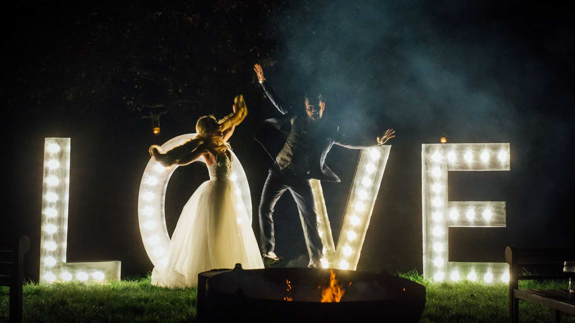 couple in front of prop hire wedding letters