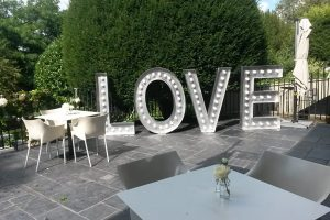 prop hire love sign outdoors