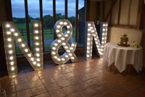 N&N intials set up at barn with cake